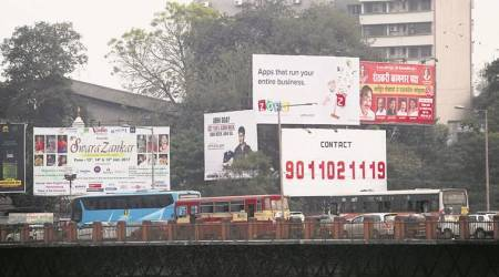 PMC takes strict action against illegal hoardings