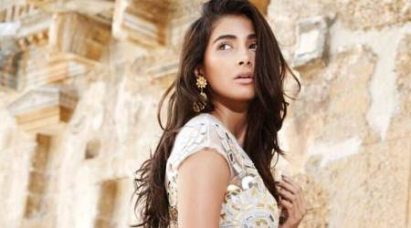 Pooja Hegde lands a special song in Ram Charan starrer Rangasthalam