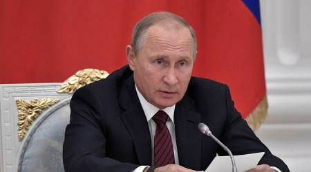 Russian President Vladimir Putin urges tough action against onlineextremism