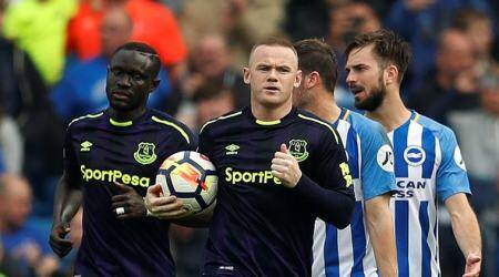 Late Wayne Rooney penalty helps Everton earn a 1-1 draw against Brighton and Hove Albion
