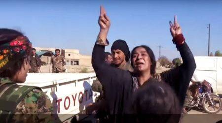 VIDEO: Syrian woman celebrates by ripping off her black robes after breaking free from ISIS