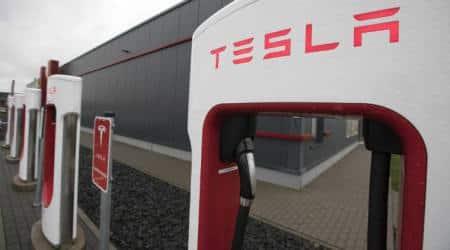Automakers plan electric car blitz even as Tesla burnsbillions