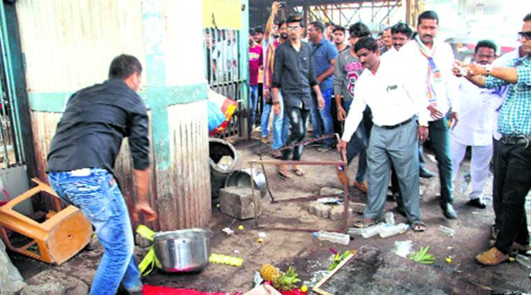 MNS activists drive away illegal hawkers from railway bridge