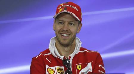 Sebastian Vettel hails under fire team principal Maurizio Arrivabene as a key man for Ferrari