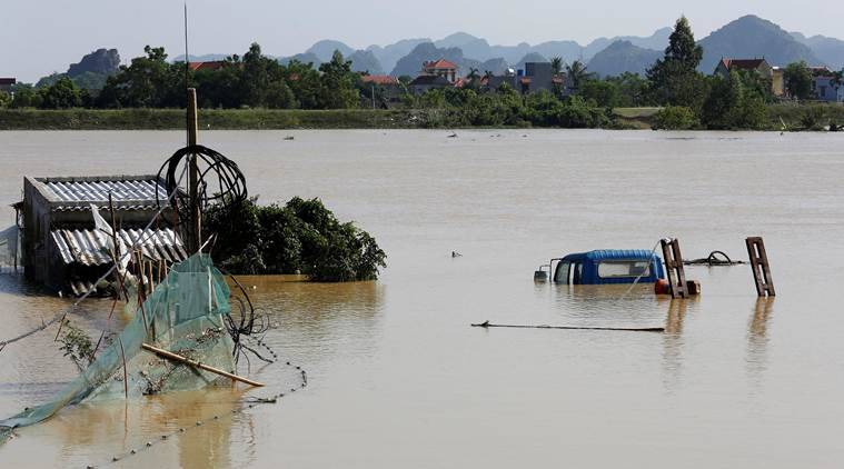 Vietnam, Vietnam floods, Vietnam flooding, Vietnam villages, vietnam death toll, Vietnam news, world news