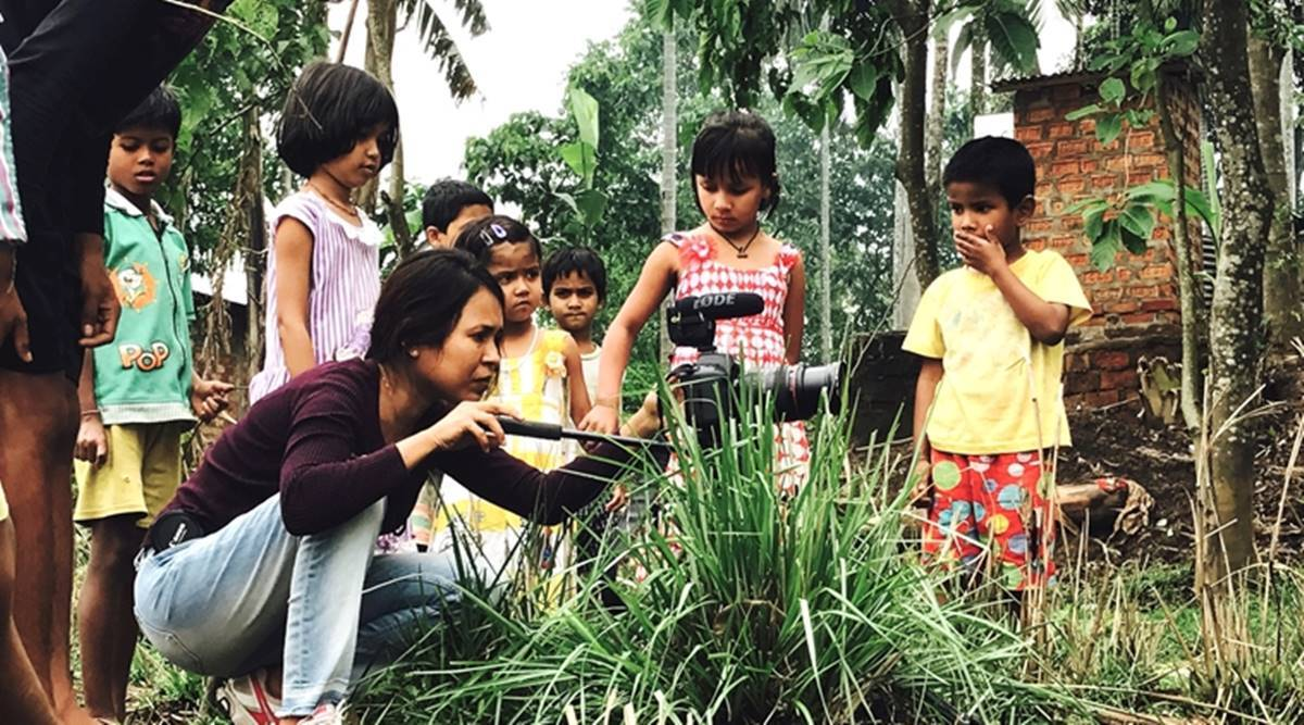 Rima Das with her young cast and crew at the shoot
