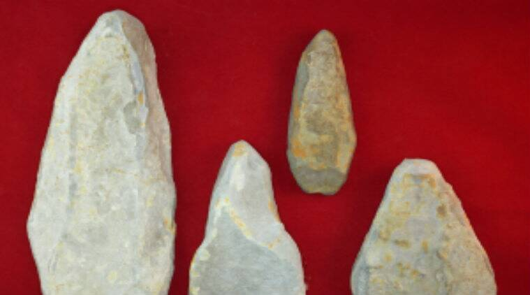 Archaeologists, Bronze Age stone tools, Clwydian Range Archaeological Group, Wales excavation site, limestone rough slabs, tools size, ornamental design tools, natural boulders