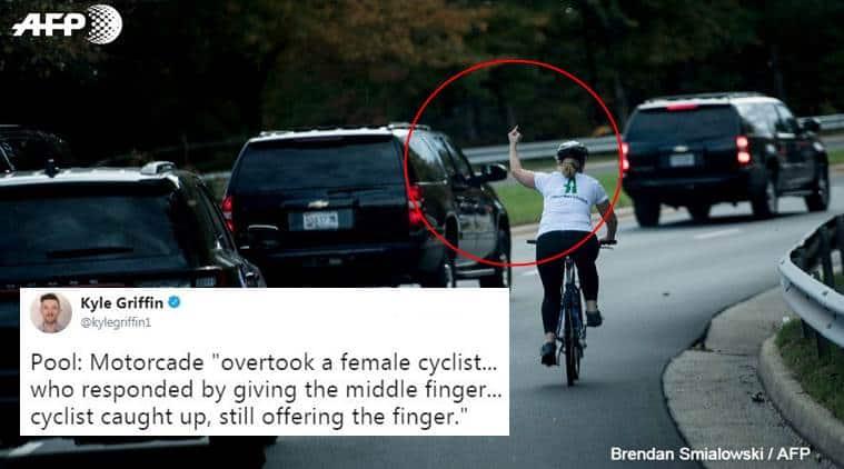 donald trump, woman middle finger donald trump, woman cyclist shows middle finger donald trump, donald trump trolled photo, indian express, indian express news