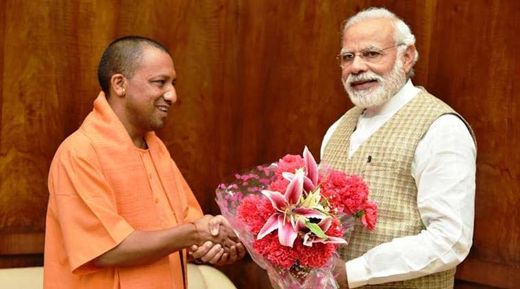 Narendra Modi, yogi adityanath, uttar pradesh, up, adityanath, chief minister yogi adityanth, up rss, up bjp, The Monk Who Became Chief Minister, biography of Yogi Adityanath, UP elections, Narendra Modi and Yogi adityanath, Narendra Modi rally, Yogi adityanath rally, Gujarat elections, Modi governmenet, Yogi Adityanath government, indian express, express column