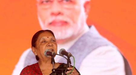 Arriving in bus from Gujarat, new MP Governor Anandiben Patel takes driver's seat