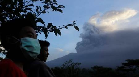 Some Bali flights resume after Mount Agung volcano interrupts travel