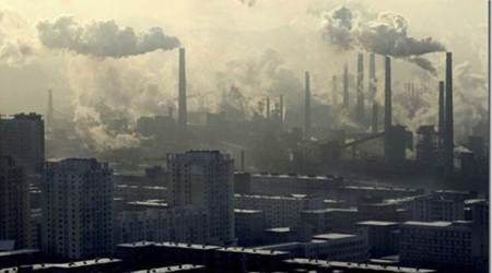 China factory output slows as government cracks down on pollution