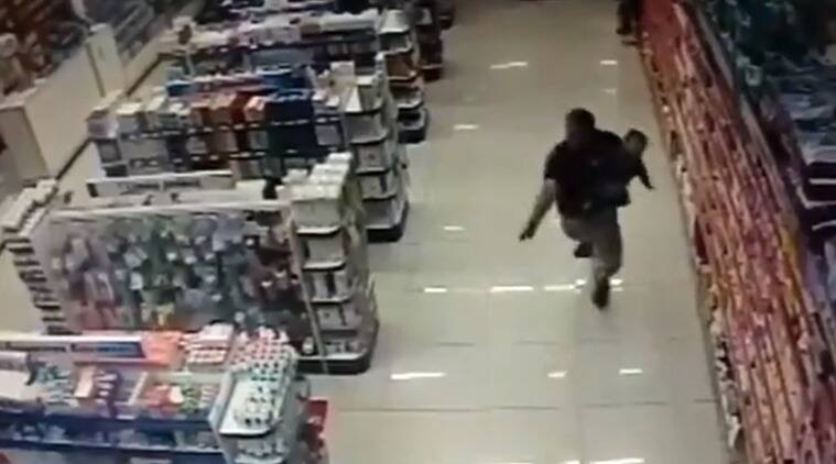 Off-duty cop stops armed robbery in Brazil while holding child, firing gun