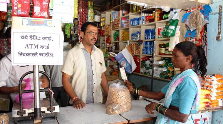 Demonetisation anniversary, demonetisation, demonetisation on year later, demonetisation dhasai village, first cashless village, dhasai digital economy, point of sale machine, e-wallet, PayTM, Freecharge, demonetisation news