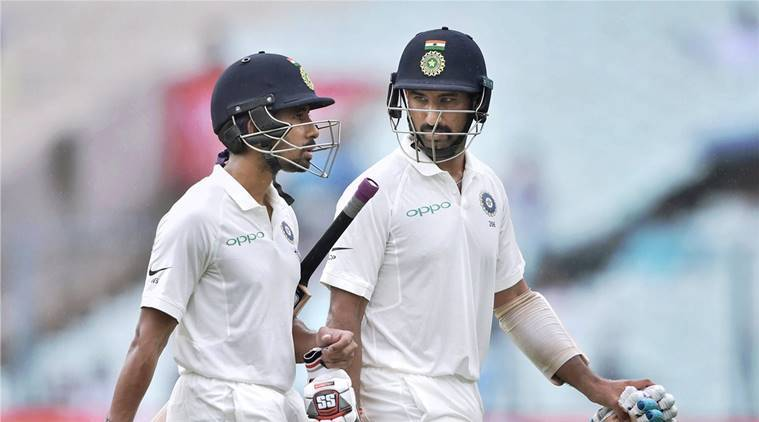 cheteshwar pujara and wriddhiman saha against sri lanka