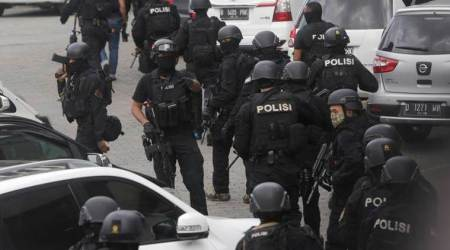 Indonesian police shoot dead 2 men in police station attack