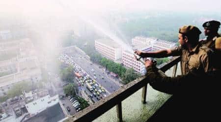 Delhi pollution, delhi pollution ITO, ITO water sprinkled, delhi pollution measures