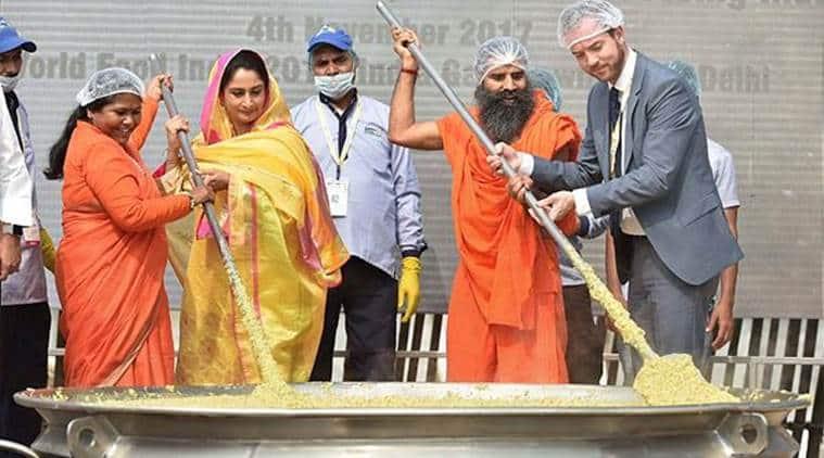 khichdi, khichdi world record, Guinness world record, khichdi guinness record, Baba Ramdev, Ramdev on khichdi, World India Food event, Sadhvi Niranjan Jyoti, Harsimrat Badal, benefits of khichdi