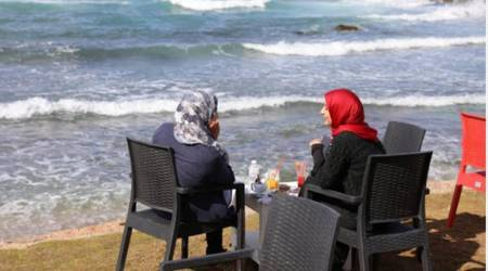 "Women find some respite in Libya's ""families only"" cafes"