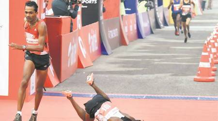 Axed Rawat shows he is India's best marathoner