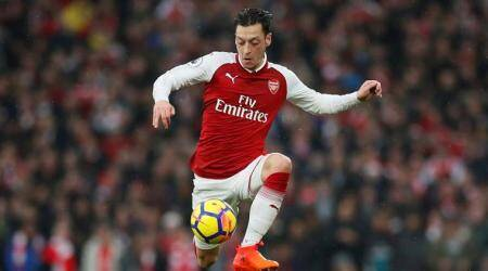 Arsenal's Mesut Ozil to miss Huddersfield game withillness