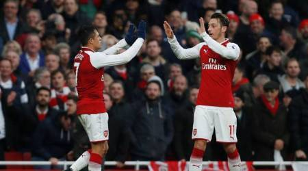 Ozil and Sanchez were the stars of arsenal's 2-0 win over spurs