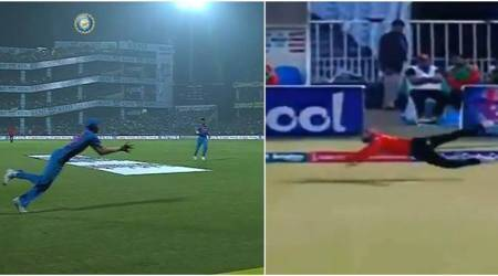 Is this catch by Ahmed Shehzad better than Hardik Pandya's effort?