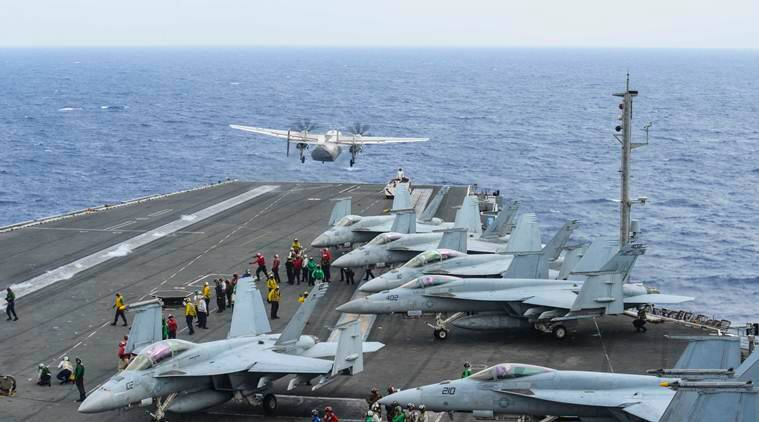 Ships, planes search for 3 American sailors missing after crash