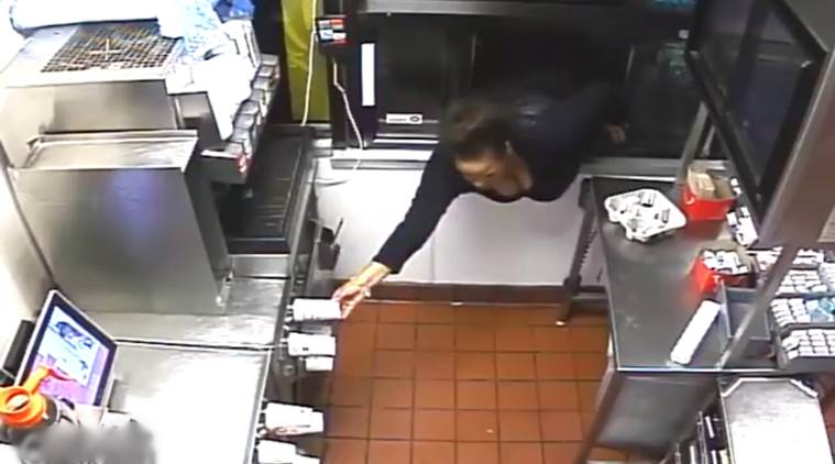 robbery video, women enters mcdonalds from window, woman steals cash from mcdonalds, bizarre robbery video, indian express, indian express news