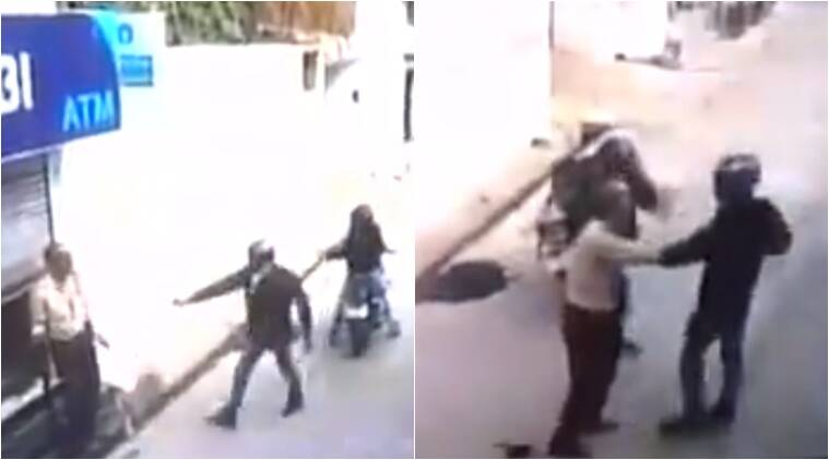 guard protects atm from armed robbers, guard does not let robbers enter atm, guard stops robbery, viral video,