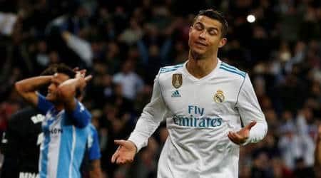 La Liga Roundup: Cristiano Ronaldo rebound gives Real Madrid nervy win at home to Malaga; Atletico hammerLevante