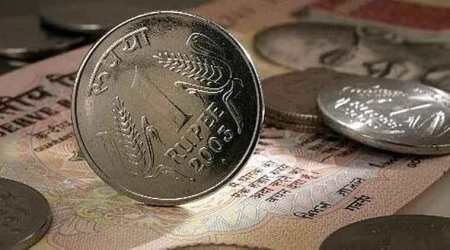 Rupee spurts 14 paise vs dollar, takes comfort from stocks