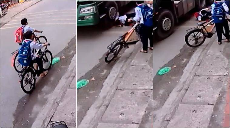 road accident, shocking road accident, narrowly escape road accident, accident narrow escape, Vietnam, Vietnam kids saved truck, viral video, indian express