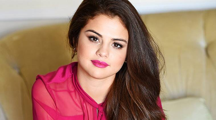 Selena gomez suits up as billboards woman of the year the indian selena gomez is named billboards woman of the year with a photo shoot voltagebd Image collections