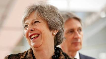 UK ministers back PM Theresa May on Brexit but she faces battle inparliament
