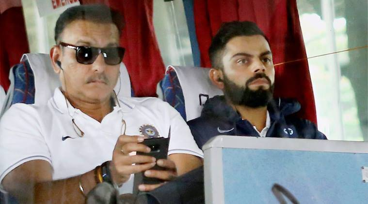Ravi Shastri and Virat Kohli in the team bus