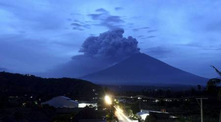 Bali volcano ash drifts 4.7 miles high, airport shut third day