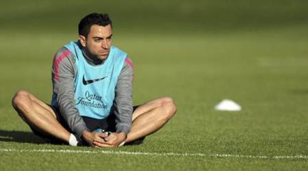 Xavi Hernandez to continue playing until end of year
