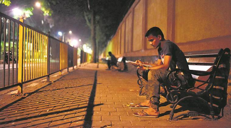 Students study at night in abhyas gali