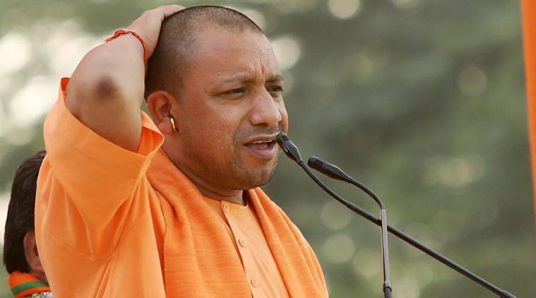 People of Gujarat have taught Manmohan how to speak and Rahul to visit temples: Yogi