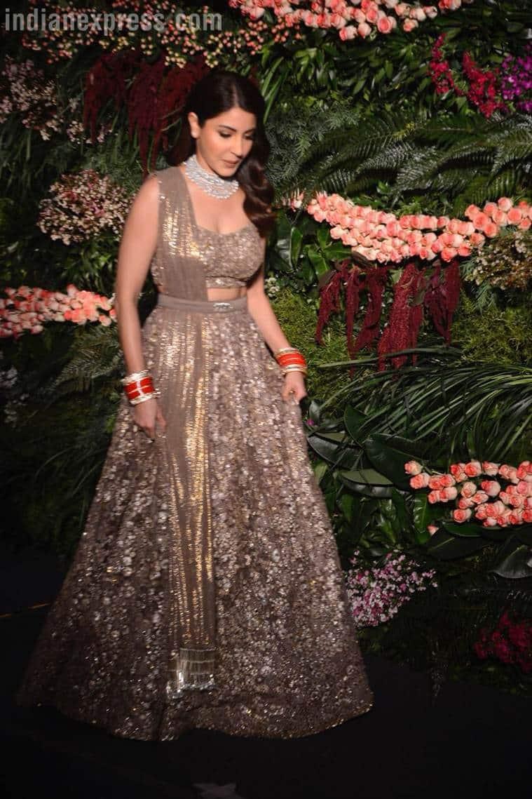 ccdf5a2bf93c Anushka Sharma-Virat Kohli are pure gold in Sabyasachi and Raghavendra  Rathore outfits at their Mumbai reception