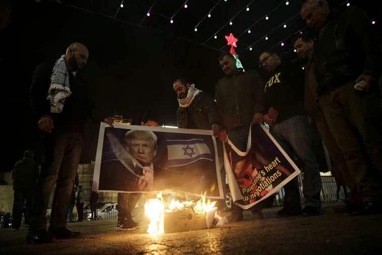 Palestinian set fire donald trump poster