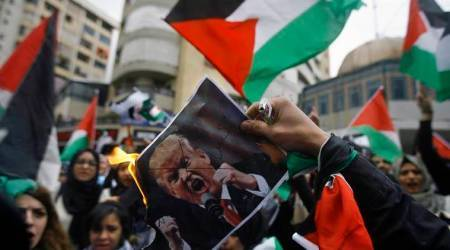 Jerusalem row: Palestinian protesters set fire to placards of US vice president Mike Pence in Bethlehem
