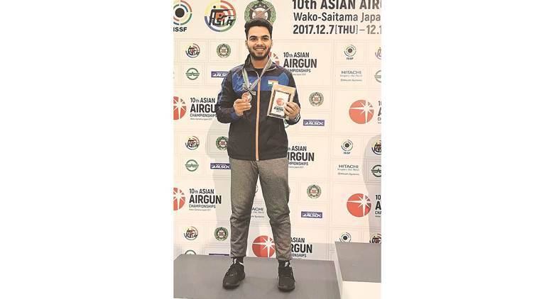 arjun babuta, chandigarh shooter, asian airgun championship 2017, waki city japan, sharp shooter, silver medal, junior category, 10 m rifle pistol category, indian express
