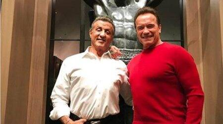 Sylvester Stallone gets a surprise visit from fellow muscleman Arnold Schwarzenegger on Christmas