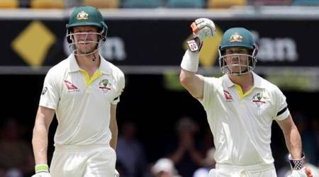 Australia's David Warner, right, and Cameron Bancroft walk off the field after winning the match against England during their Ashes cricket test in Brisbane, Australia