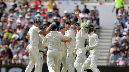 Australia celebrate the wicket of Joe Root in the third Test on Day 4