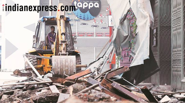 kamala mills fire, bmc demolition, mumbai pub fire, fire stafety norms, byculla, ghatkopar, vikhroli, illegal constuction razed, mumbai news, indian express