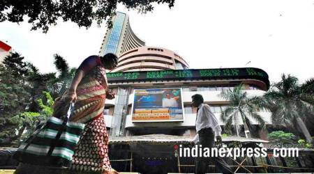 Sensex slips from record in see-saw trade; IT bucks trend