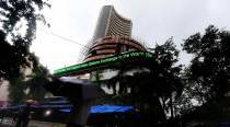Late buying lifts Sensex, exit polls take centre-stage